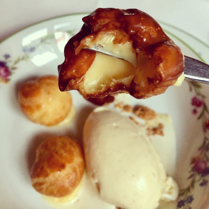 Profiteroles with ice cream and chocolate sauce